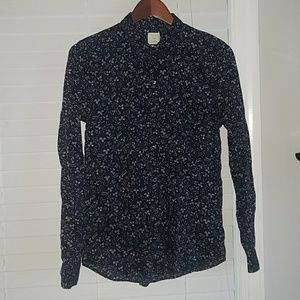 Navy button up shirt with white floral pattern